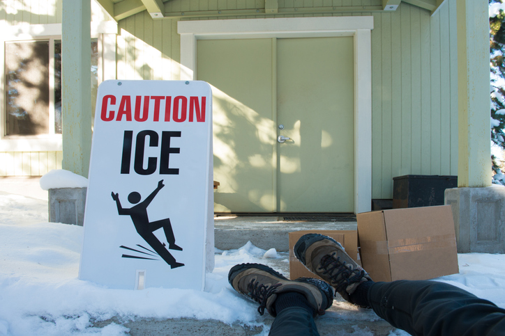 Stephen C. Carter, PC Attorney at Law | Hartwell, GA | delivery person with boxes has slipped in icy conditions