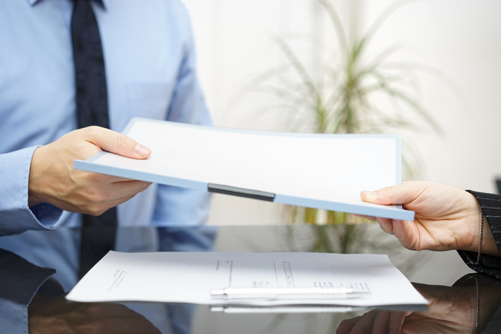 Stephen C. Carter, PC Attorney at Law | Hartwell, GA | man and woman exchanging contract or document
